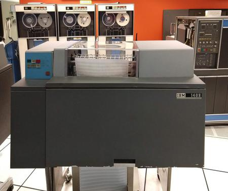 The IBM 1403 printer in front of the popular 1401 business computer (right) and 729 tape drives (left).