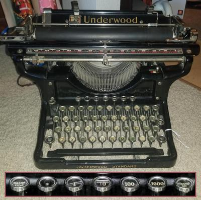 "Underwood 6 typewriter with decimal tabulator (1934). Inset shows the decimal tab keys enlarged: ""Tab Stop Clear"", ""."", ""1"", ""10"", ""100"", ""1000"", ""Tab Stop Set"". Interestingly, the platen scale shows 132 tick marks. Photo courtesy of J Makoto Smith."