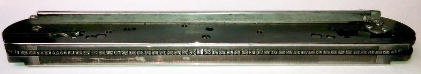 The type chain from the IBM 1401's printer. The chain has 48 different characters, repeated five times.