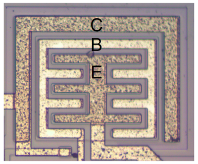 A large, high-current NPN output transistor in the 555 timer chip. The collector (C), base (B) and emitter (E) are labeled.