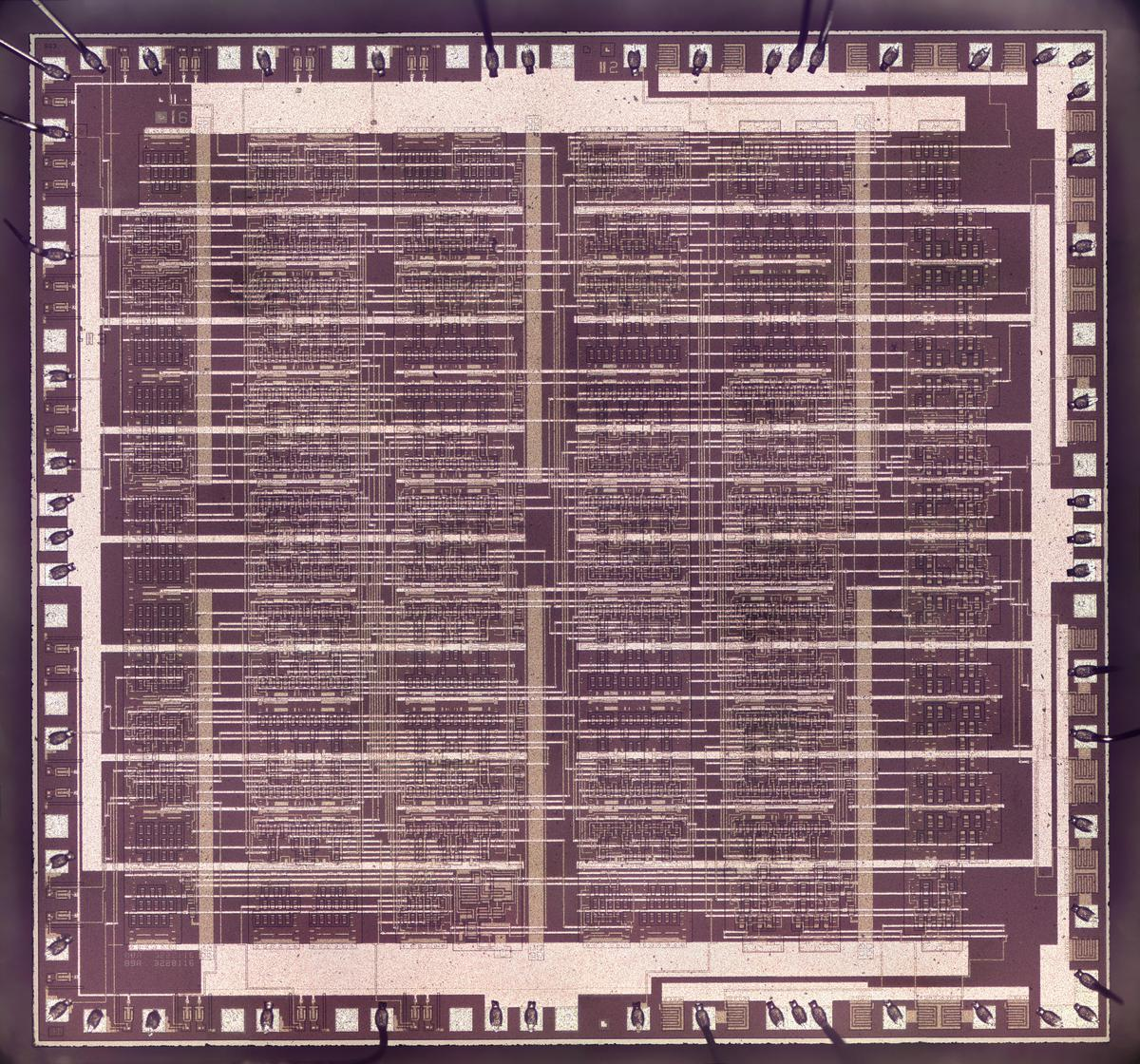 Die photo of the fake 8086, showing the metal layer on top. The thick horizontal and vertical strips provide power and ground, while the other wiring connects the components.