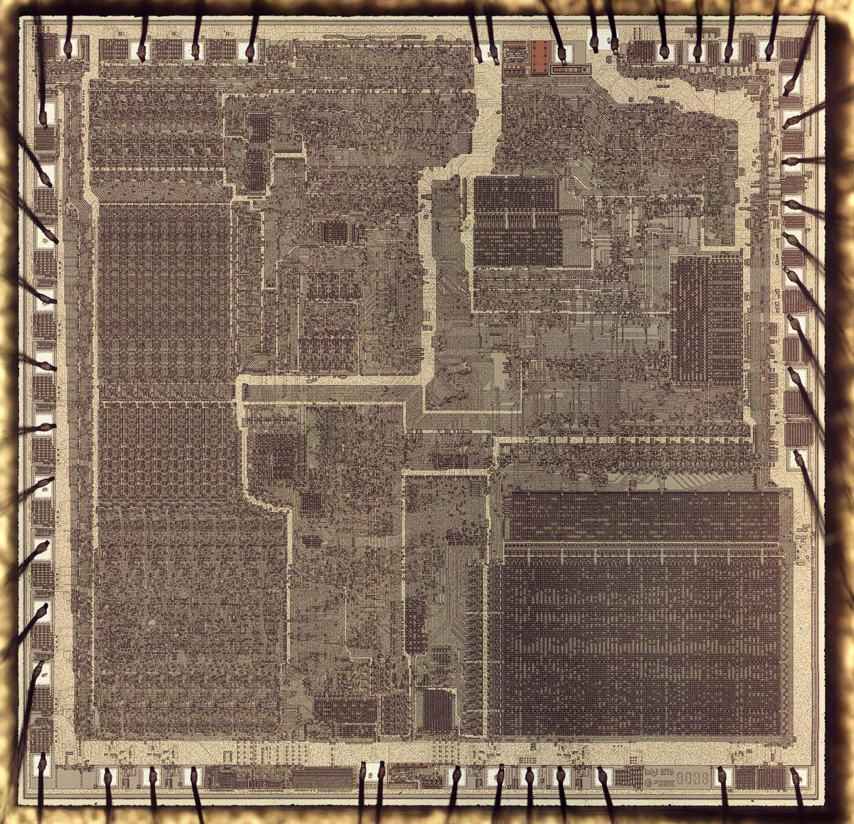 Die photo of the 8086, showing the metal layer. Around the edges, bond wires are connected to pads on the die. Click for a large, high-resolution image.