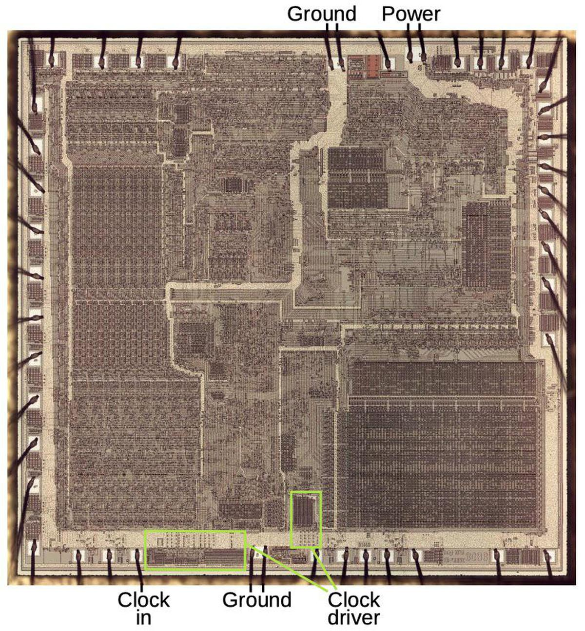 Die photo of the 8086 showing power connection (top) and ground connections (top, bottom). The clock circuitry is at the bottom.