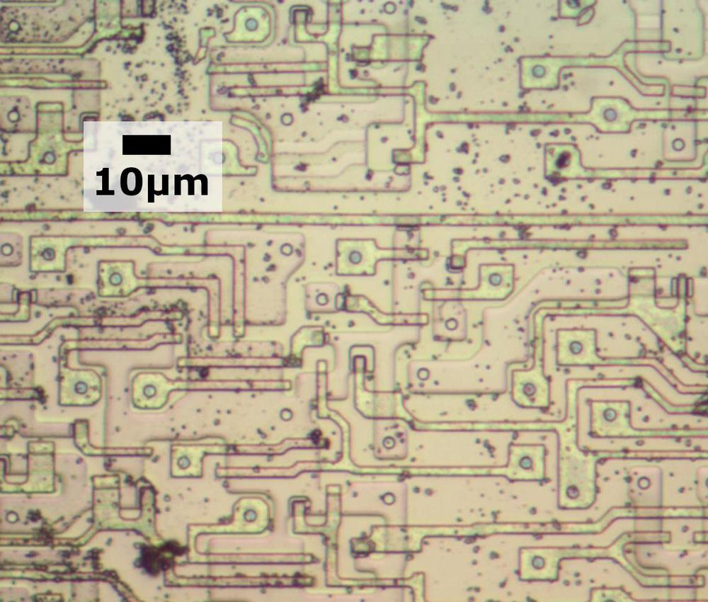 Transistors in the later 8086 chip. There are many vias between the silicon or polysilicon and the metal (which has been removed).
