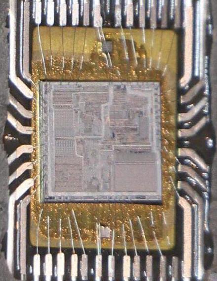 A closeup of the 8086 chip showing the silicon die and the bond wires connecting it to the lead frame.