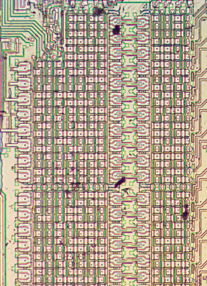Part of the constant ROM, with the metal layer removed. The three columns of larger transistors are used to select between rows.