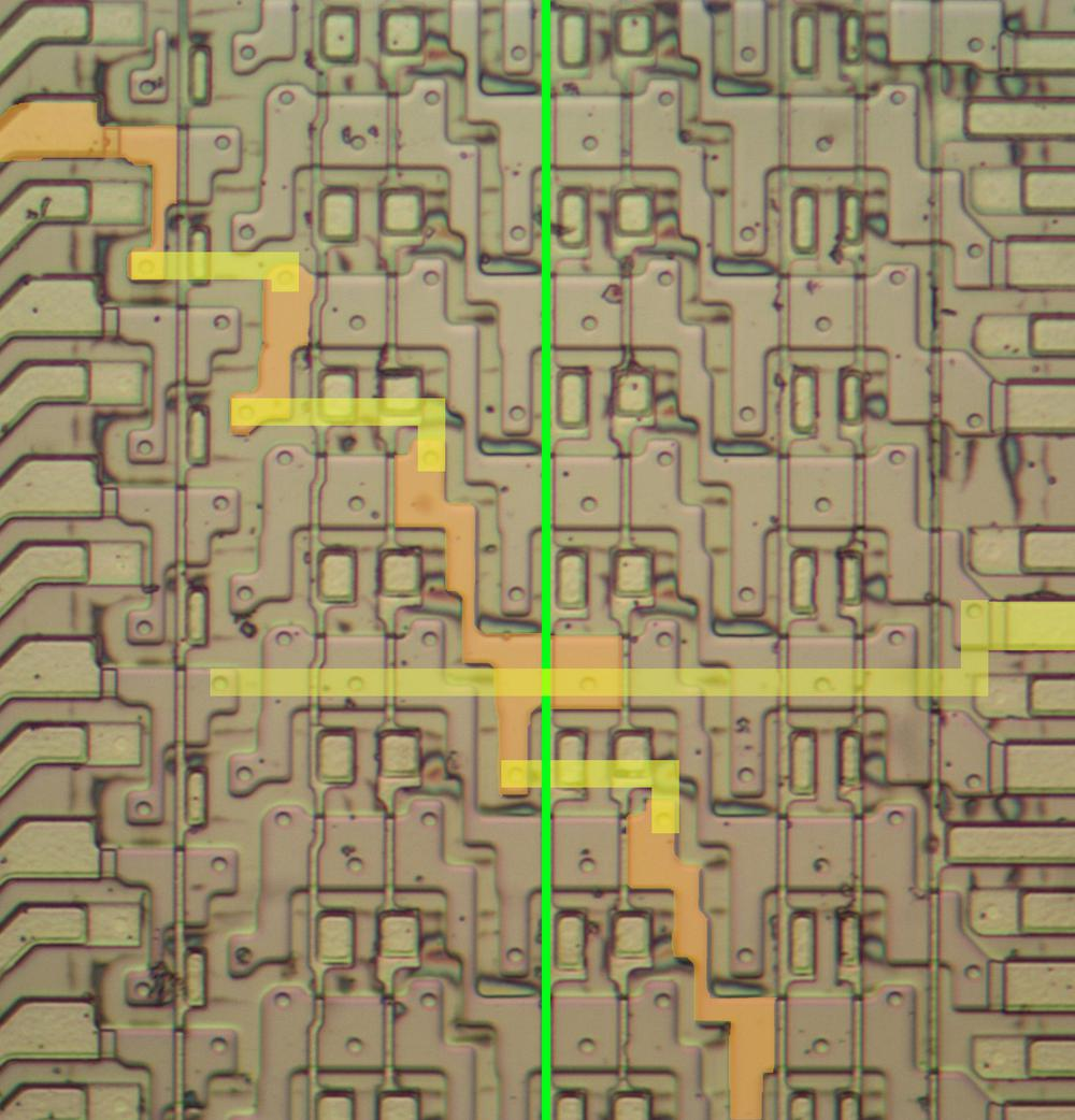 Closeup of the silicon circuitry for the bit shifter. The path of one signal is shown, as controlled by the shift-by-three control (green).