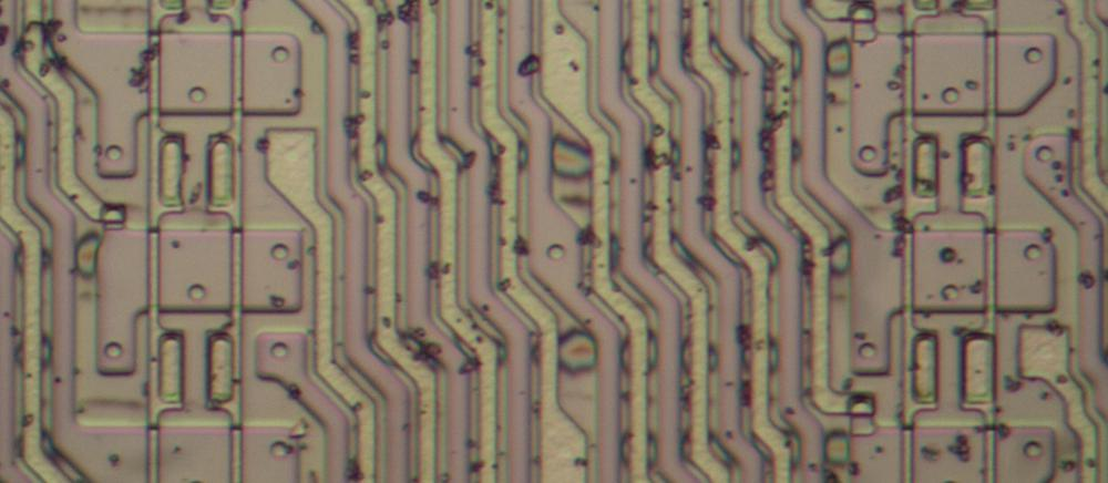 Wiring in the byte shifter consists of alternating, tightly-packed silicon and polysilicon lines. The large rectangles on either side are pairs of transistors, controlled by vertical polysilicon lines.