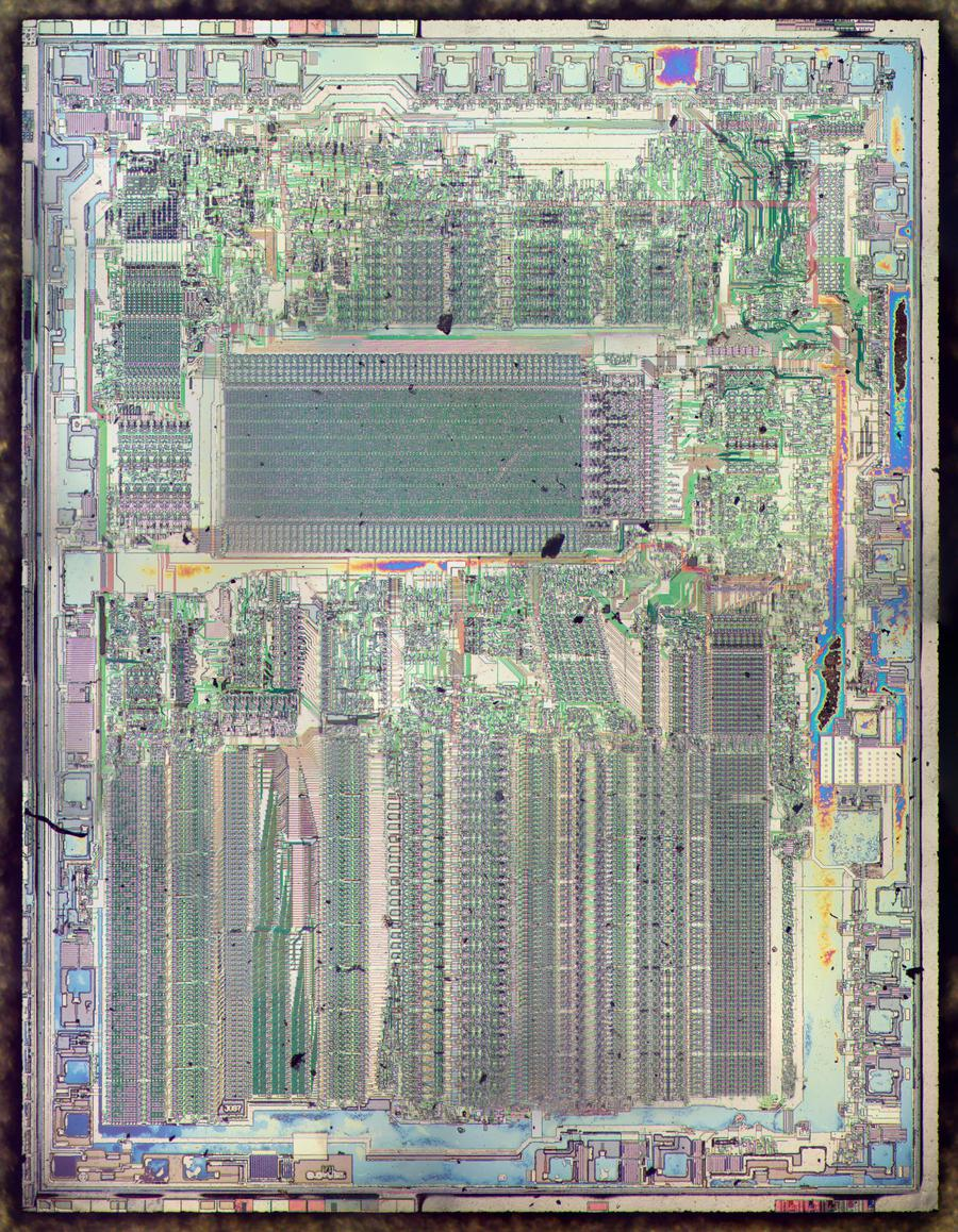 Die photo of the 8087 with the metal layer removed. The colors are due to some of the oxide layer remaining. Click for a larger image.
