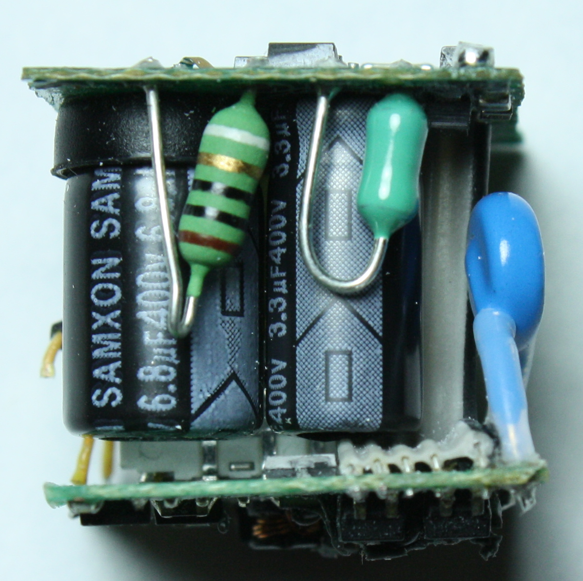Apple Iphone Charger Teardown Quality In A Tiny Expensive Package Transistors Dc Voltage Grounded With Ac Input Electrical Showing The Fusible Resistor Striped Inductor Green