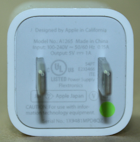 Designed by Apple in California. Model No A1265 Made in China. Input: 100-240V 50/60 Hz 0.15A. Output 5V 1A.  54PT. E233466 ITE.  UL listed Power Supply Flextronics.  Apple Japan. CAUTION: For use with information technology equipment. Marked with green dot.