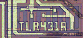 A junction capacitor in the TL431 chip with interdigitated PN junctions. The die id is written in metal on top.