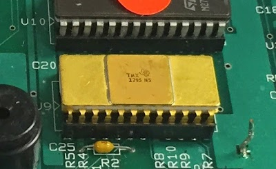 The TMX 1795 microprocessor installed in a circuit board.