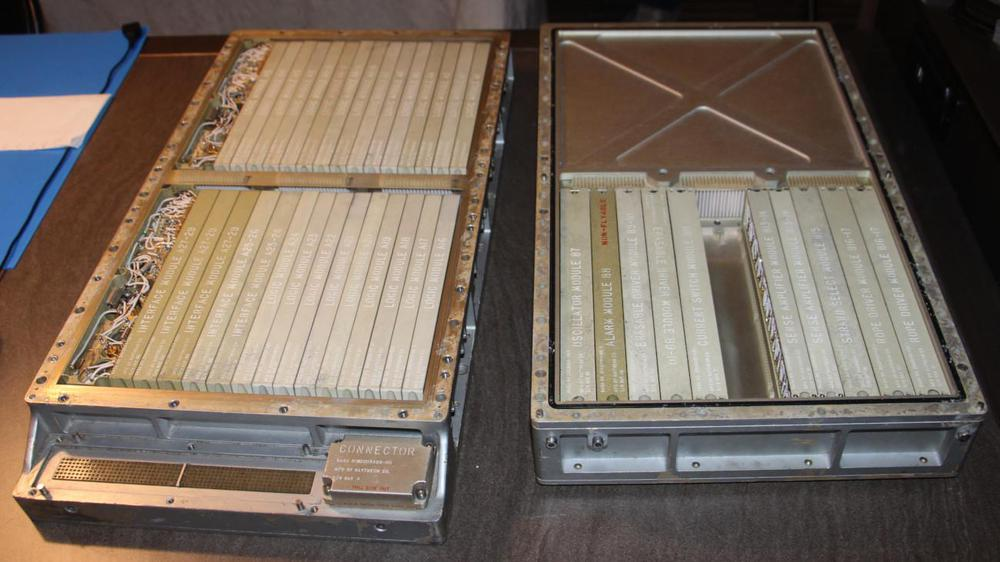 The Apollo Guidance Computer with the two trays separated. The tray on the left holds the logic circuitry built from NOR gates. The tray on the right holds memory and supporting circuitry.