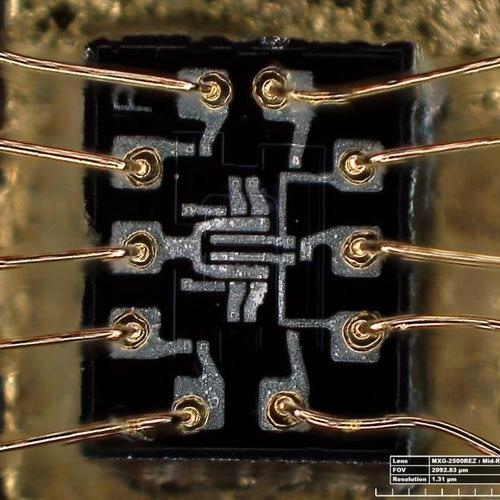 Die photo of the dual 3-input NOR gate used in the AGC. The ten bond wires around the outside of the die connect to the IC's external pins. Photo by Lisa Young, Smithsonian.