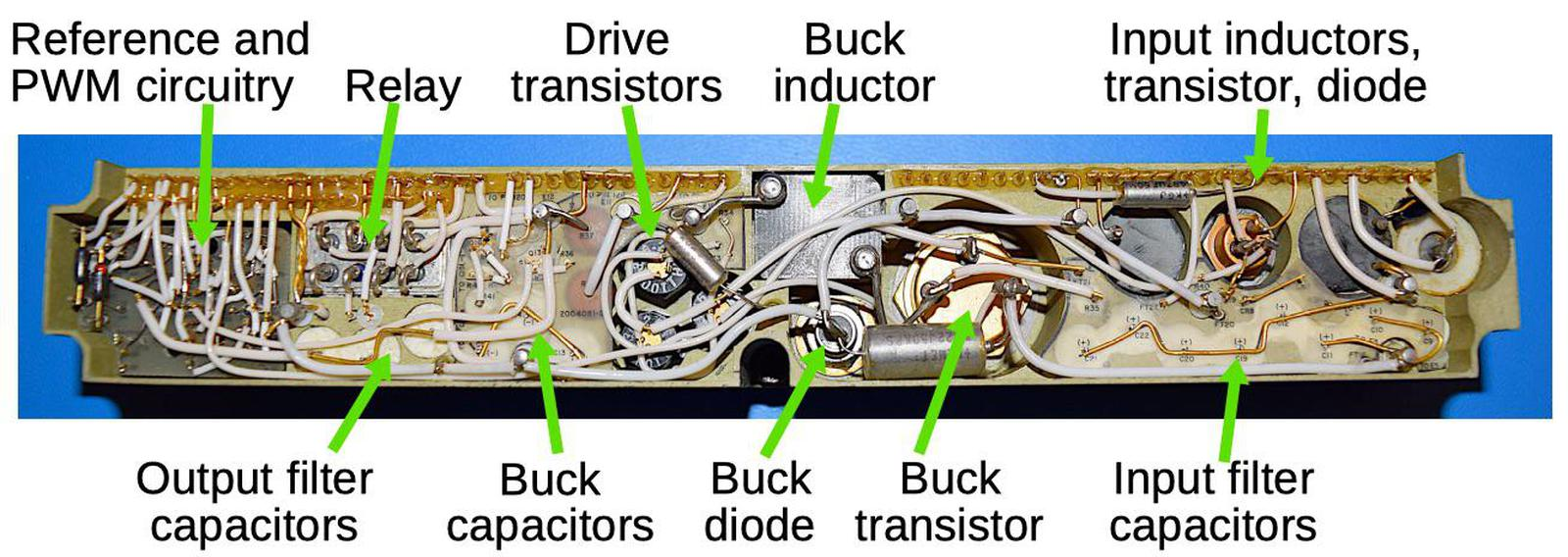 The major components of the AGC's power supply. The components for the buck converter are much larger than the control circuitry.