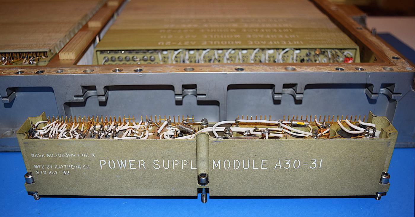 The power supply module in front of the AGC. The module in position A30 provides +14 volts, while the (identical) module in position A31 provides +4 volts.