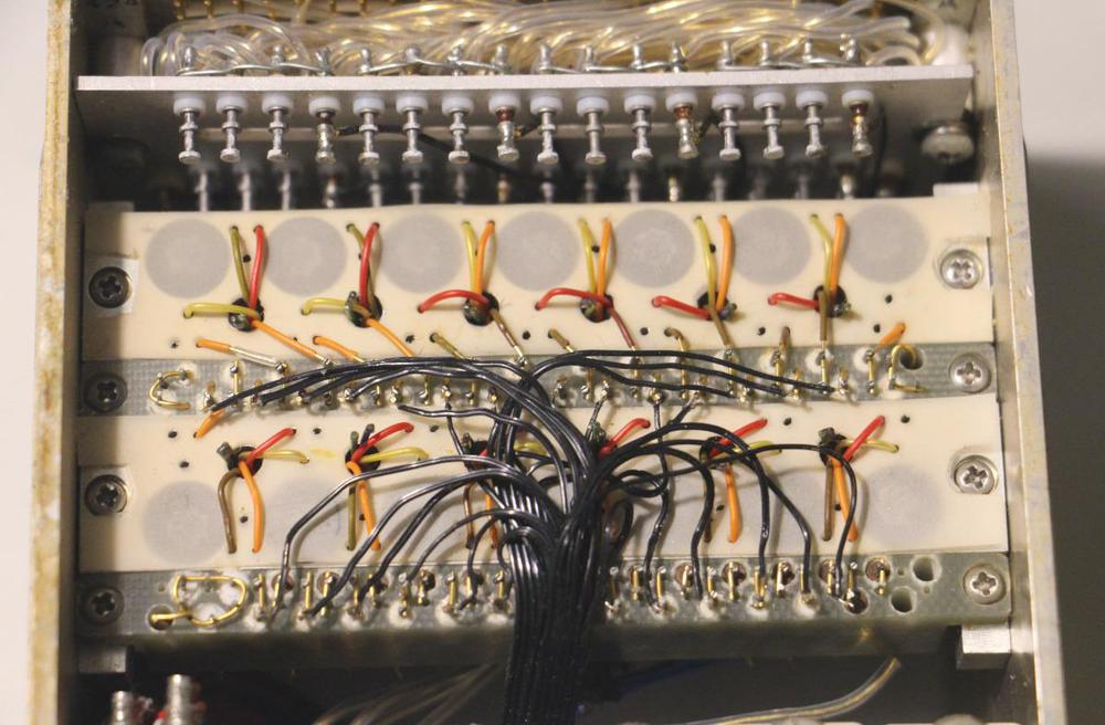 A closeup of the cordwood circuitry in a rope simulator box.