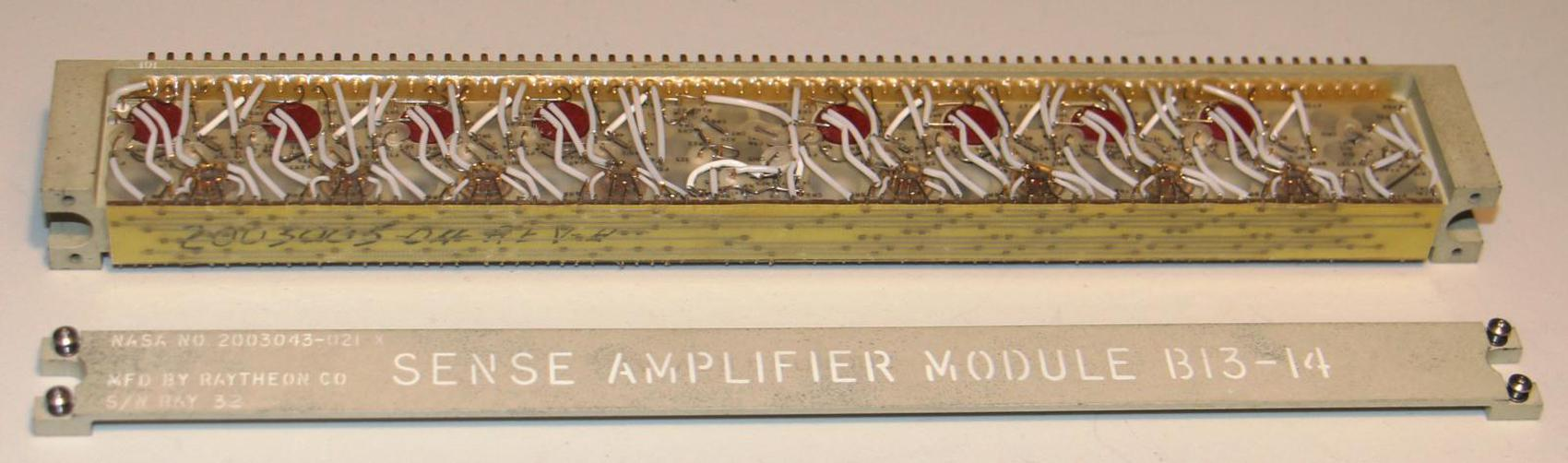 Sense amplifier module with the top removed. Note the nickel ribbon interconnect at the top of the module.
