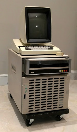 The Xerox Alto II XM computer. Note the video screen is arranged in portrait mode. Next to the keyboard is a mouse. The Diablo disk drive is below the keyboard. The base contains the circuit boards and power supplies.