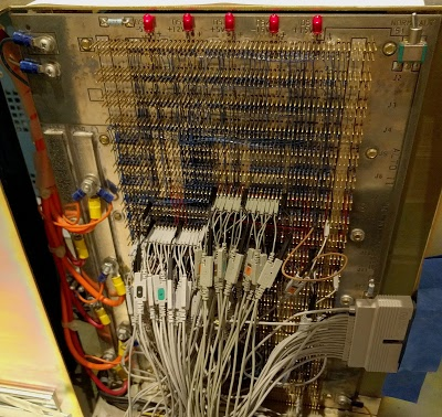 We added more probes to the Alto's backplane to monitor the processor bus. The probes are connected to a vintage Agilent logic analyzer.