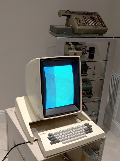 The Xerox Alto running a CRT test program. Antique mechanical calculators are in the background.