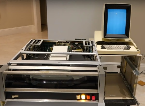 The Xerox Alto's drive powered up, along with monitor (showing a white screen).