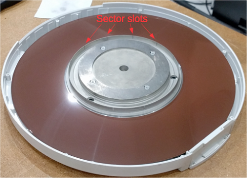 The hard disk pack for the Xerox Alto has 12 sectors. Slots cut into the disk hub trigger a signal for each sector.