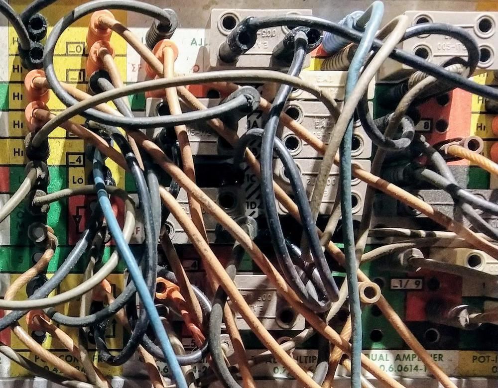 "An analog computer was ""programmed"" by plugging wires into the patch panel. This panel is from an EAI analog computer at the Computer History Museum."