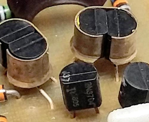 Critical transistors are held together with metal clips to ensure they stay at the same temperature. The differential pair is on the right, while the transistors on the left buffer the inputs.
