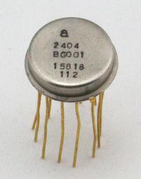 The module was packaged inside a TO-8 metal can, which is wider and flatter than a typical metal can IC. It is just a bit narrower than a dime.