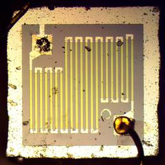 This resistor controlled current through the op amp. The bond wire in the upper left was knocked off the pad during photography.