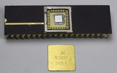 The MC6820 chip with the metal lid popped off to reveal the silicon die.