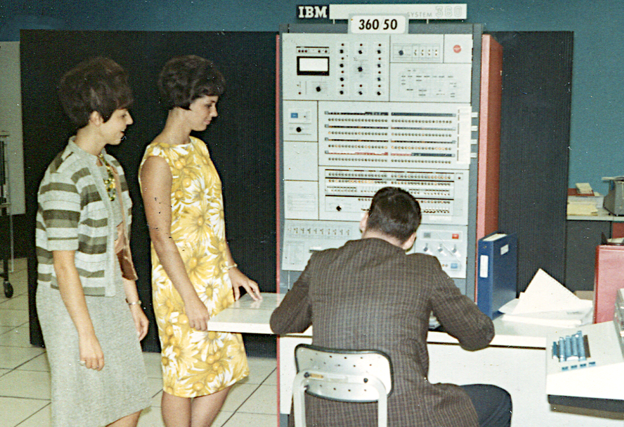 IBM S/360 Model 50. The console was attached to the main frame, about 5 feet deep. The storage frame and power frame are the black cabinets at the back. Photo from Pinterest.
