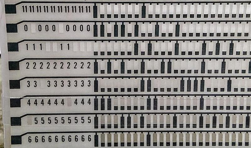 Detail of a CCROS sheet. It is programmed by punching holes in it with a keypunch.