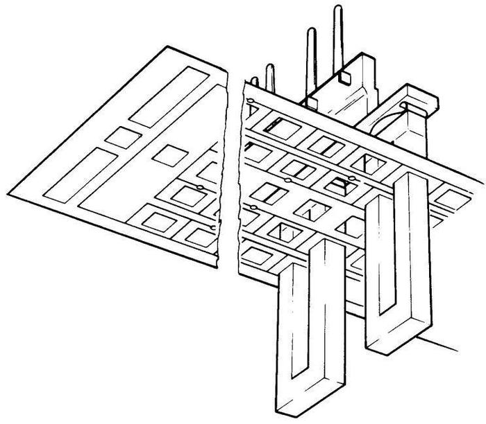 Structure of the transformers, viewed from underneath. Each transformer consists of a U-piece that goes through the tapes, and an I-bar that completes the transformer. From Model 40 Functional Units.