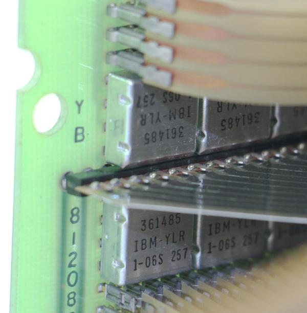 "This closeup of the diode board shows the square metal SLT modules labeled 361485. Each one contains 8 diodes. The Mylar tape connections are at the top and bottom, while the ""fin"" in the middle is the wiring from the TROS module to the rest of the computer."