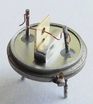 Inside a germanium alloy-junction transistor used in the IBM 1401 computer. This is an IBM 083 NPN transistor. Photo from http://ibm-1401.info/GermaniumAlloy.html