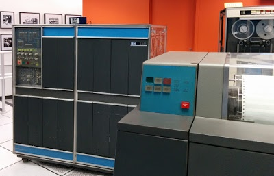 The IBM 1401 mainframe from the 1960s. The 1403 line printer is to the right, and a 792 tape drive at the back.