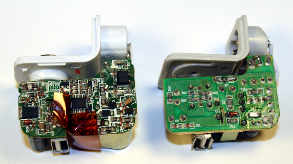 The circuit board of a real iPad charger (left) and a counterfeit charger (right).