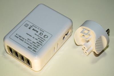 The KMS TC-09 (AC09) 4-port USB charger. The power plug can be interchanged for use in different countries.