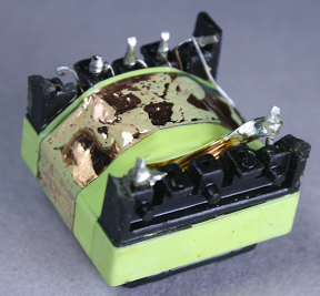 A copper 'belly band' provides a shield around the flyback transformer.