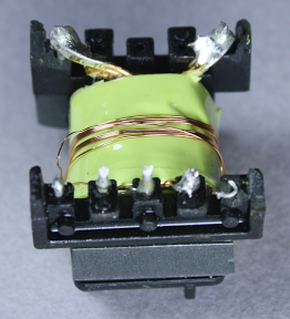 The first winding in the flyback transformer powers the internal circuits of the charger