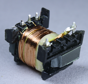 The first half of the primary winding in the flyback transformer. Note the 3mm white boundary tape at the right that keeps the winding away from the edge.