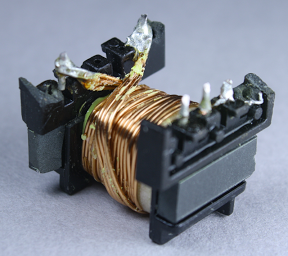 To support high current, the secondary winding in the flyback transformer is four strands of thick wire. Note the 3mm white boundary tape at the right that keeps the winding away from the edge.