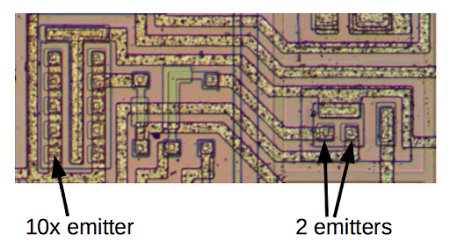 The LM308's current source contains some interesting transistors. The transistor on the left has 10 emitters wired together, creating a transistor with an effective emitter size of 10 times normal. The transistor on the right has two separate emitters, providing two current outputs.