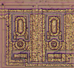 Closeup of two strange transistors on the LM308 die.