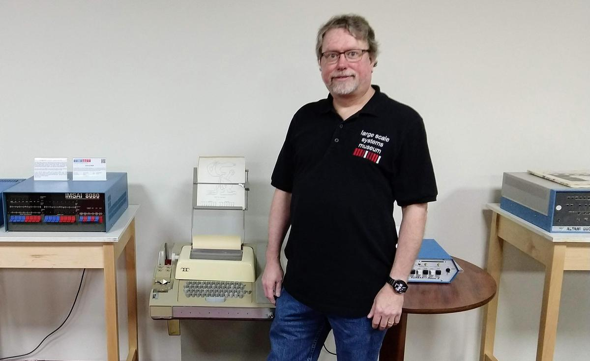 Corey Little, curator of the microcomputer collection, in front of Imsai, ASR-33 teletype, Kenbek-1 replica, and Altair.