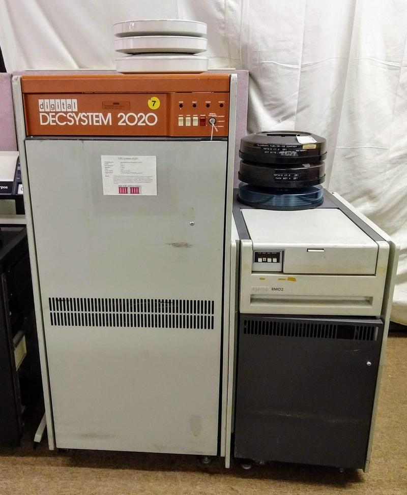 A DECsystem-2020 mainframe next to an RM02 disk drive. The drive's removable disk packs each store 67 megabytes.