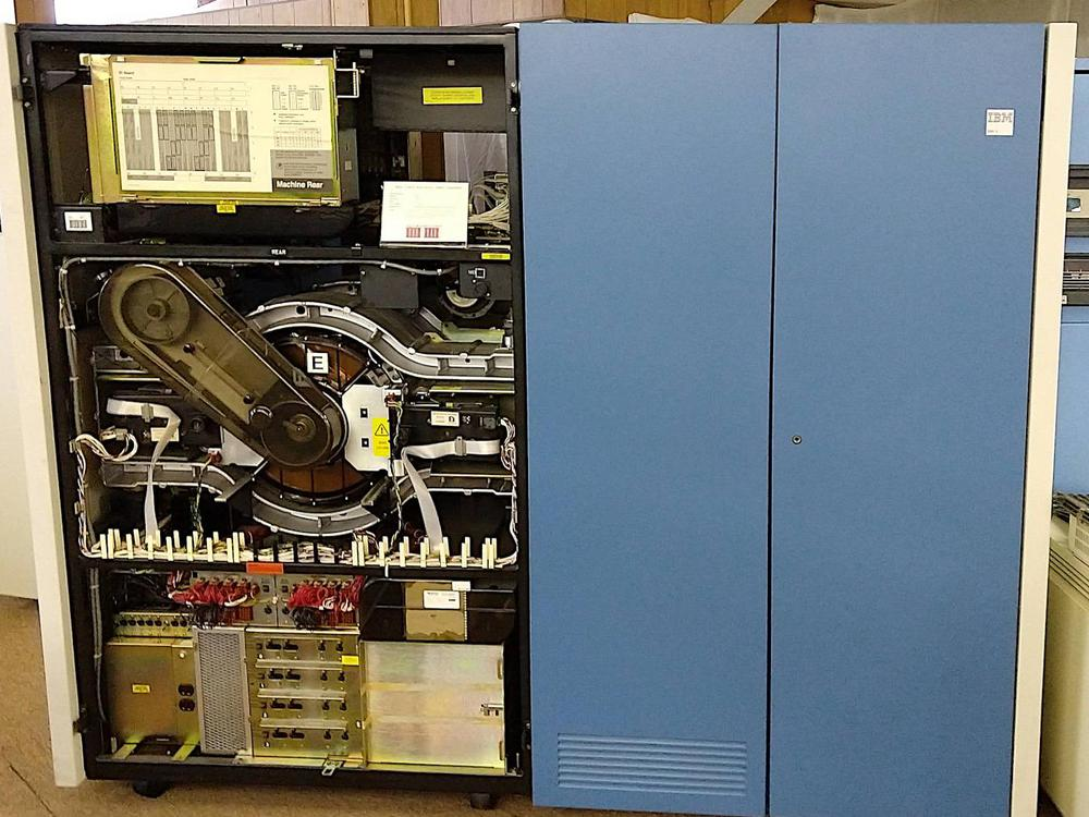 "The IBM 3380E disk system stored 5 gigabytes of data. The 14-inch disk platter is in the center, labeled ""E""."
